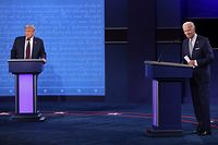 CLEVELAND, OHIO - SEPTEMBER 29: U.S. President Donald Trump and Democratic presidential nominee Joe Biden look out to the audience at end of the first presidential debate at the Health Education Campus of Case Western Reserve University on September 29, 2020 in Cleveland, Ohio. This is the first of three planned debates between the two candidates in the lead up to the election on November 3.   Win McNamee/Getty Images/AFP == FOR NEWSPAPERS, INTERNET, TELCOS & TELEVISION USE ONLY ==