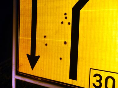 According to police, the sign had been peppered with nine bullet holes, thought to be from a rifle.