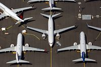 "(FILES) In this file photo taken on August 1, 2019 Boeing 737 MAX airplanes are parked on Boeing property near Boeing Field on August 13, 2019 in Seattle, Washington. - A Boeing pilot behind the 737 MAX certification in 2016 told a colleague a key flight handling system was ""running rampant"" during simulator tests, according to documents reviewed on October 18, 2019, by AFP. The Boeing employees quipped about problems during simulations of the Maneuvering Characteristics Augmentation System, a flight-handling mechanism that is believed to be at the center of two MAX crashes that killed 346 people. (Photo by David Ryder / GETTY IMAGES NORTH AMERICA / AFP)"