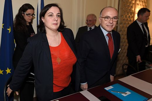 Emmanuelle Cosse(L) and French Interior Minister Bernard Cazeneuve