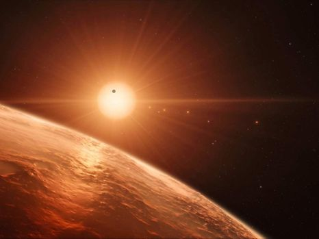 """This handout artist�s impression released by the European Southern Observatory on February 22, 2017 shows the view just above the surface of one of the planets in the TRAPPIST-1 system.  The stunning discovery of seven Earth-like planets orbiting a small star in our galaxy opens up the most promising hunting ground to date for life beyond the Solar System, researchers said Wednesday. All seven are within 20 percent of the size and mass of our own planet and almost certainly rocky, and three are ideally situated to harbour life-nurturing oceans of water, they reported in the journal Nature.  / AFP PHOTO / European Southern Observatory / M. Kornmesser / RESTRICTED TO EDITORIAL USE - MANDATORY CREDIT """"AFP PHOTO / ESO/M. Kornmesser/spaceengine.org"""" - NO MARKETING NO ADVERTISING CAMPAIGNS - DISTRIBUTED AS A SERVICE TO CLIENTS"""