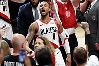 PORTLAND, OREGON - APRIL 23: Damian Lillard #0 of the Portland Trail Blazers reacts after hitting the game winning shot in Game Five of the Western Conference quarterfinals against the Oklahoma City Thunder during the 2019 NBA Playoffs at Moda Center on April 23, 2019 in Portland, Oregon. The Blazers won 118-115. NOTE TO USER: User expressly acknowledges and agrees that, by downloading and or using this photograph, User is consenting to the terms and conditions of the Getty Images License Agreement.   Steve Dykes/Getty Images/AFP (Photo by Steve Dykes/Getty Images) == FOR NEWSPAPERS, INTERNET, TELCOS & TELEVISION USE ONLY ==