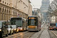 BRUSSELS, BELGIUM. January 2017. Busy street traffic on the Rue de la Regence street of Brussels, Belgian tram and cars. The Justice Palace on the background.