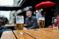 Customers enjoy beers on a terrace in Brussels on May 8, 2021, as the Belgium government eased the restrictions put in place to curb the spread of the coronavirus, Covid-19. (Photo by Kenzo TRIBOUILLARD / AFP)