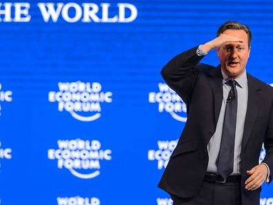 Britain's Prime Minister David Cameron gestures during a session at the World Economic Forum on January 21.