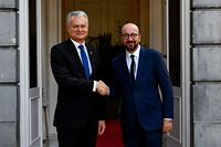 Lithuania's president Gitanas Nauseda (L) shakes hands with Belgian Prime Minister Charles Michel (R) ahead of their meeting, on September 05, 2019 in Brussels. (Photo by DIRK WAEM / various sources / AFP) / Belgium OUT