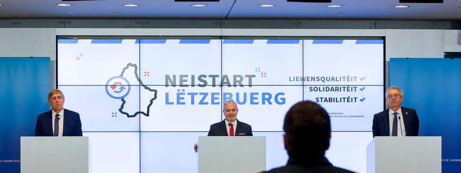 Vor dem Motto des Aufschwungs präsentieren sich die Minister Bausch, Kersch und Gramegna (v.l.).
