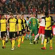 Players of BV 09 Borussia Dortmund react after the Europa League Round of 16 second leg football match between FC Salzburg and Borussia Dortmund in Salzburg, Austria, on March 15, 2018.   / AFP PHOTO / APA / KRUGFOTO / Austria OUT