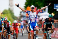 Team Groupama-FDJ rider France's Arnaud Demare celebrates as he finished first in the stage ten of the 102nd Giro d'Italia - Tour of Italy - cycle race, 145kms from Ravenna to Modena on May 21, 2019. (Photo by Luk BENIES / AFP)