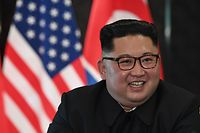 North Korea's leader Kim Jong Un reacts at a signing ceremony with US President Donald Trump (not pictured) during their historic US-North Korea summit, at the Capella Hotel on Sentosa island in Singapore on June 12, 2018.  Donald Trump and Kim Jong Un became on June 12 the first sitting US and North Korean leaders to meet, shake hands and negotiate to end a decades-old nuclear stand-off. / AFP PHOTO / SAUL LOEB