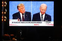 WEST HOLLYWOOD, CALIFORNIA - SEPTEMBER 29: A broadcast of the first debate between President Donald Trump and Democratic presidential nominee Joe Biden is played on a TV at The Abbey, which seated patrons at socially distanced outdoor tables, on September 29, 2020 in West Hollywood, California. The debate being held in Cleveland, Ohio is the first of three scheduled debates between Trump and Biden.   Mario Tama/Getty Images/AFP == FOR NEWSPAPERS, INTERNET, TELCOS & TELEVISION USE ONLY ==