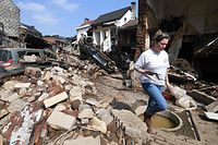 A resident walks among the destroyed buildings in Pepinster, near Liege, on July 19, 2021, following heavy rains and flooding across areas of France, Belgium, Germany and The Netherlands. - Rescue workers scrambled to find survivors and victims of the devastation wreaked by the worst floods to hit western Europe in living memory, which have already left more than 150 people dead and dozens more missing. (Photo by JOHN THYS / AFP)
