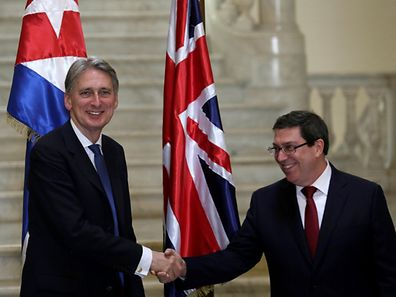Britain's Foreign Secretary Philip Hammond (L) shakes hands with Cuba's Foreign Minister Bruno Rodriguez Parrilla during their meeting in Havana on Thursday.