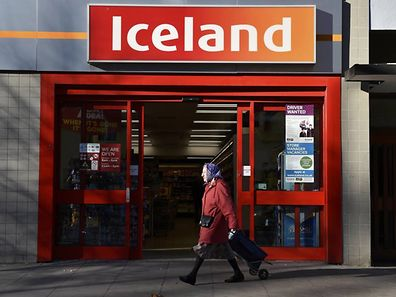 A woman walks past an Iceland store in London, Britain,  November 25, 2016.