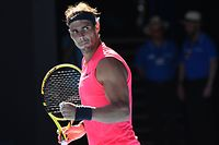 Spain's Rafael Nadal celebrates after beating Spain's Pablo Carreno Busta during their men's singles match on day six of the Australian Open tennis tournament in Melbourne on January 25, 2020. (Photo by William WEST / AFP) / IMAGE RESTRICTED TO EDITORIAL USE - STRICTLY NO COMMERCIAL USE
