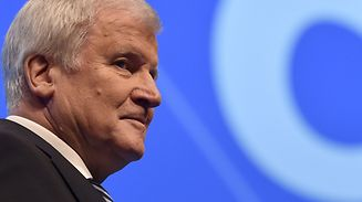 Bavaria's state Premier and chairman of the Bavarian Christian Social Union (CSU) party, Horst Seehofer stands at the stage after his speech on December 16, 2017 in Nuremberg, southern Germany, during the congress of their CSU party, the Bavarian sister party of German Chancellor's CDU. / AFP PHOTO / Christof STACHE