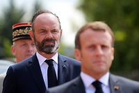 (FILES) In this file photo taken on June 18, 2020 French President Emmanuel Macron (front) and French Prime Minister Edouard Philippe attend the traditional annual ceremony at the Mont-Valerien, a memorial for the French who fought against the Nazis and those who were killed by the occupying forces, in Suresnes, west of Paris. - The French presidency announced on July 3, 2020 that French Prime Minister Edouard Philippe and his government have resigned. (Photo by Ludovic MARIN / POOL / AFP)