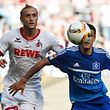 Hamburg's Croatian midfielder Ivo Ilicevic (R) and Cologne's midfielder Marcel Risse vie for the ball during the German first division Bundesliga football match 1FC Cologne vs Hamburger SV in Cologne, western Germany, on August 29, 2015.  AFP PHOTO / PATRIK STOLLARZ