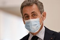 (FILES) In this file photo taken on December 10, 2020 former French President Nicolas Sarkozy looks on as he arrives for the last day of his trial on corruption charges at Paris courthouse. - The Paris court on March 1, 2021 will rule on the fate of former French President Nicolas Sarkozy, against whom the prosecutor's office has requested prison for corruption and influence peddling. Four years in prison, including two years suspended, have been requested for the former head of state and his two co-defendants, his lawyer Thierry Herzog and former senior magistrate Gilbert Azibert. (Photo by Bertrand GUAY / AFP)