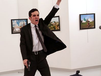 Mevlut Mert Altintas shouts after shooting Andrei Karlov the Russian ambassador to Turkey, at an art gallery in Ankara, Turkey December 19, 2016. Burhan Ozbilici, The Associated Press/Courtesy of World Press Photo Foundation/Handout via REUTERS   THIS IMAGE HAS BEEN SUPPLIED BY A THIRD PARTY. FOR EDITORIAL USE ON WORLD PRESS PHOTO ONLY. NO RESALES. NO CROPPING. TURKEY OUT. NO COMMERCIAL OR EDITORIAL SALES IN TURKEY