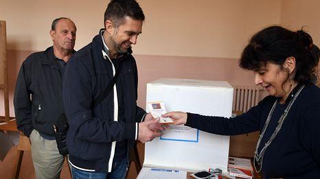 A citizen prepares to vote in the referendum in Venice.