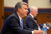 """FBI Director Christopher Wray (L) and National Counterterrorism Center Director Christopher Miller testify before a House Homeland Security Committee hearing about """"Worldwide threats to the Homeland"""" on Capitol Hill on September 17, 2020 in Washington, DC. (Photo by John McDonnell / various sources / AFP)"""