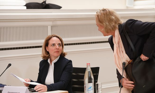 Family Minister Corinne Cahen (left) and Health Minister Paulette Lenert (right) chat in Parliament in July after the report on the government's response to care home deaths