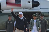 US President Donald Trump (L),  and First Lady Melania Trump walk to Air Force One before departing from Luis Mu�iz Air National Guard Base in Carolina, Puerto Rico on October 3, 2017. Nearly two weeks after Hurricane Maria thrashed through the US territory, much of the islands remains short of food and without access to power or drinking water. / AFP PHOTO / MANDEL NGAN