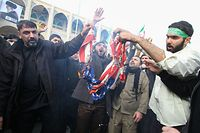 "TOPSHOT - Iranians burn a US flag during a demonstration against American ""crimes"" in Tehran on January 3, 2020 following the killing of Iranian Revolutionary Guards Major General Qasem Soleimani in a US strike on his convoy at Baghdad international airport. - Iran warned of ""severe revenge"" and said arch-enemy the United States bore responsiblity for the consequences after killing one of its top commanders, Qasem Soleimani, in a strike  outside Baghdad airport. (Photo by ATTA KENARE / AFP)"