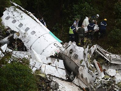 Rescue teams recover the bodies of victims of the LAMIA airlines charter that crashed in the mountains of Cerro Gordo,
