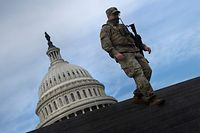 TOPSHOT - A member of the National Guard provides security at the US Capitol on January 14, 2021, in Washington, DC, a week after supporters of US President Donald Trump attacked the Capitol, and ahead of the inauguration of President-elect Joe Biden on January 20. (Photo by Brendan Smialowski / AFP)