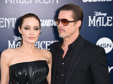 """(FILES) This file photo taken on May 28, 2014 shows Angelina Jolie and Brad Pitt arriving for the world premiere of Disney's """"Maleficent,""""  at El Capitan Theatre in Hollywood, California.  US actress Angelina Jolie has filed for divorce from her husband Brad Pitt after two years of marriage and 12 years together, announced on September 20, 2016 by the website TMZ celebrity. / AFP PHOTO / ROBYN BECK"""