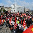People holding flags of French CGT union gather during a demonstration over a bitterly-disputed labour law on May 31, 2016 in Bordeaux, ahead of the inauguration of the Cite du Vin by French President.  France was bracing for fresh transport chaos on May 31, 2016 with railway workers striking just 11 days before Euro 2016 in a bitter labour dispute that has sparked months of protests. The rolling train strike called by the powerful CGT union is expected to affect around half of national and regional services by the time it takes full effect on June 1, 2016.  / AFP PHOTO / NICOLAS TUCAT