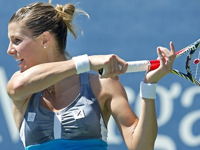Mandy Minella of Luxembourg returns to Kristyna Plisova of the Czech Republic during their women's match at the 2012 US Open tennis tournament August 29, 2012 in New York.   AFP PHOTO/DON EMMERT
