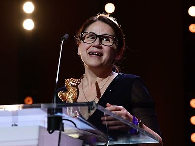 "Hungarian director Ildiko Enyedi receives the Golden Bear for Best Film ""On Body and Soul""at the awards ceremony of the 67th Berlinale film festival in Berlin on February 18, 2017.  / AFP PHOTO / Tobias SCHWARZ"
