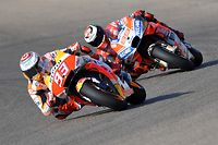 (FILES) In this file photo taken on September 21, 2018 Repsol Honda's Spanish rider Marc Marquez (L) and Ducati Team's Spanish rider Jorge Lorenzo ride during the MotoGP first free practice of the Aragon Grand Prix at the Motorland racetrack in Alcaniz. (Photo by JOSE JORDAN / AFP)
