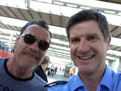 Police take selfie after stopping Arnold Schwarzenegger riding bike through Munich train station