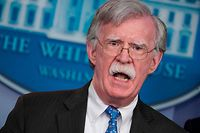 """(FILES) In this file photo taken on January 28, 2019 National Security Advisor John Bolton speaks during a briefing in the Brady Briefing Room of the White House in Washington, DC. - The White House on January 29, 2020 said that former national security advisor John Bolton cannot publish in its current form a book reportedly containing explosive evidence concerning President Donald Trump's impeachment trial. The National Security Council said after preliminary review of the manuscript -- a vetting process applied to any White House employees writing books -- that it contained """"significant amounts of classified information."""" (Photo by Mandel NGAN / AFP)"""