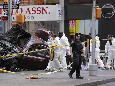 Police investigate the scene where a vehicle was driven onto a sidewalk and struck pedestrians in Times Square