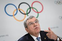 "(FILES) In this file photo taken on January 11, 2020 International Olympic Committee (IOC) President Thomas Bach attends a press conference closing an Olympic session in Lausanne. - Bach said on March 20, 2020 the organisation was ""considering different scenarios"" for the Tokyo Games, but was optimistic about holding the event as scheduled despite the coronavirus pandemic. (Photo by FABRICE COFFRINI / AFP)"