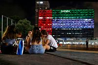 The city hall in the Israeli coastal city of Tel Aviv is lit up in the colours of the United Arab Emirates national flag on August 13, 2020. - Israel and the UAE agreed to normalise relations in a landmark US-brokered deal, only the third such accord the Jewish state has struck with an Arab nation. The agreement, first announced by US President Donald Trump on Twitter, will see Israel halt its plan to annex large parts of the occupied West Bank, according to the UAE. (Photo by JACK GUEZ / AFP)