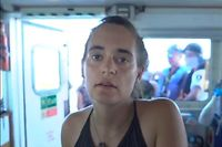 "This handout video grab released on the Twitter account of NGO Sea Watch, shows Carola Rackete, captain of the Sea Watch 3 rescue ship off the coast of Lampedusa. Captain Rackete entered Italian waters despite the threat of a hefty fine, she said she is prepared to go to prison over her bid to bring to safety the 42 migrants rescued off the Libyan coast. (Photo by HO / Sea Watch / AFP) / RESTRICTED TO EDITORIAL USE - MANDATORY CREDIT ""AFP PHOTO / SEA WATCH"" - NO MARKETING NO ADVERTISING CAMPAIGNS - DISTRIBUTED AS A SERVICE TO CLIENTS --- NO ARCHIVE ---"