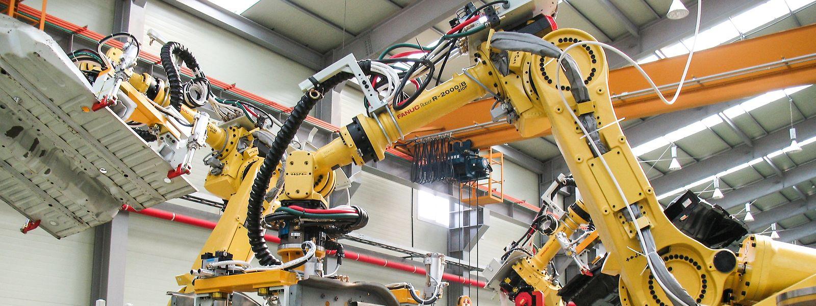 Mit künstlichen Augen können Roboter wie die hier von Fanuc komplexere Aufgaben erfüllen.