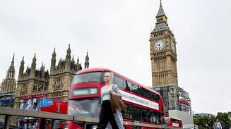 The face of the Great Clock of the Elizabeth Tower, commonly referred to as Big Ben, is pictured at the Houses of Parliament in London, on August 17, 2017, as a red London bus crosses Westminster Bridge. British retail sales rose in July, slightly beating expectations, official data showed on Thursday, even though household incomes are still feeling the squeeze from a Brexit-fuelled slump in the pound. / AFP PHOTO / Tolga Akmen