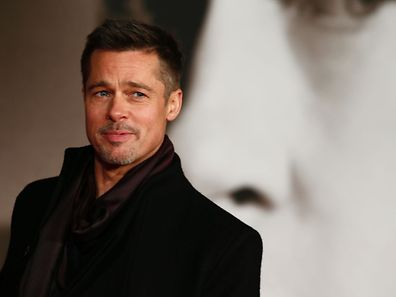 US actor Brad Pitt poses for photographers after arriving to attend the UK premiere of the film 'Allied' in Leicester Square