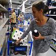 Erica McMillan stocks up with what's left on the shelves at Walmart in Oahu, Hawaii on   August 22, 2018, in preparation for the arrival of Hurricane Lane. - Residents of Hawaii on August 22 were bracing for a rare landfall by a powerful hurricane as they stocked up on water, food and emergency supplies. Hurricane Lane, which weakened slightly to a category 4 storm overnight, is packing 155-mile-per-hour winds and is expected to reach the archipelago's Big Island by nightfall. (Photo by Ronen ZILBERMAN / AFP)
