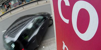 A car in Hannover, Germany, passes under a CO2 sign in 2013.