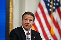 """(FILES) In this file photo taken on May 26, 2020 Governor of New York Andrew Cuomo speaks during a press conference at the New York Stock Exchange (NYSE) at Wall Street in New York City. - New York Governor Andrew Cuomo formally referred himself for investigation March 1, 2021 over allegations he sexually harassed two former aides, as he faced criticism for suggesting the women had """"misinterpreted"""" him. (Photo by Johannes EISELE / AFP)"""