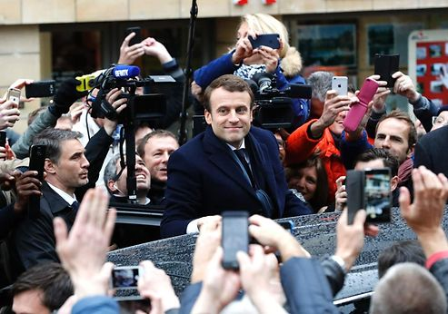 Macron, Le Pen face off in watershed French election