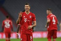 Bayern Munich's Polish forward Robert Lewandowski celebrates scoring his forth side's goal to lead 4:3 with his team during the German first division Bundesliga football match FC Bayern Munich vs Hertha Berlin on October 4, 2020 in Munich, southern Germany. (Photo by CHRISTOF STACHE / AFP) / DFL REGULATIONS PROHIBIT ANY USE OF PHOTOGRAPHS AS IMAGE SEQUENCES AND/OR QUASI-VIDEO